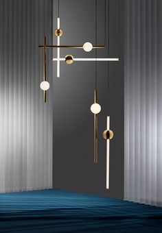 """Orion is composed of modular tubes and spheres that are each available in solid polished gold and tube light options. Broom pairs opposing metal and illuminated components """"to create bespoke constellations of light,"""" according to Lee Broom, the designer. Interior Lighting, Home Lighting, Modern Lighting, Lighting Design, Industrial Lighting, Lighting Ideas, Industrial Style, Lighting Stores, Table Lighting"""