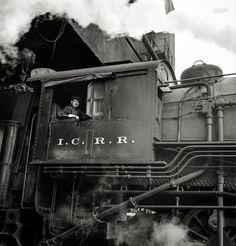 "November 1942. ""Chicago, Illinois. Engine taking on coal at an Illinois Central Railroad yard."" Medium-format negative by Jack Delano."