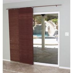 @Overstock.com - Mahogany Flat Privacy Panel Track Sliding Shade - This light-filtering bamboo shade lends a tropical island look while also providing privacy and energy-efficient insulation. Perfect for sliding patio doors, this mahogany flat-stick panel includes all necessary hardware and instillation instructions.  http://www.overstock.com/Home-Garden/Mahogany-Flat-Privacy-Panel-Track-Sliding-Shade/8306177/product.html?CID=214117 $85.49