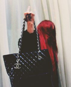 Fuck you. Red hair. All black. Chanel.