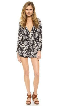 Floral romper.. this would be so cute with tights and booties