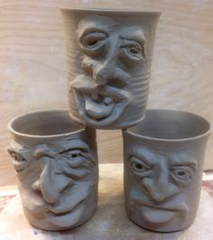 Face mugs, unfired clay. by Dave the Potter