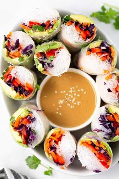 Vegetable spring rolls served with peanut dipping sauce - vegan and vegetarian dinner ideas and recipe!