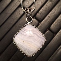 Blue Lace Agate Set In 925 Sterling Silver Pendant Beautiful light blue lace agate stone in an eye-catching sterling silver. Comes on a silver 18 inch chain. Jewelry Necklaces