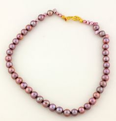 Mauve Ringed Pearls Necklace, round pink pearls, gold tone clasp by Gemjunky1 on Etsy