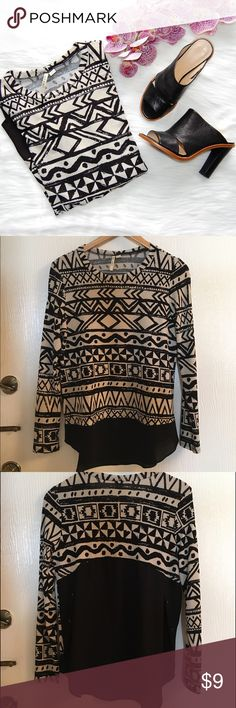 MIAMI Top Black and white tribal print top. Long sleeves. Front has a sheer panel below the hem. Rear's lower half is sheer. Polyester/spandex blend. Some pilling under the arms and a small snag on the lower front. Miami Tops