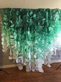 This gorgeous emerald green ombre paper garland backdrop would be a stunning accent for birthdays, weddings, or any other special occasion. This airy garland captures light beautifully to create a whimsical backdrop for any event. The displays features a beautiful reverse ombre fading from dark, medium, and light emerald green into very pale gray (looks white). Each coffee filter is hand-dyed to create the bright and bold colors. This v shaped display measures 8ft long in the middle and 4ft…