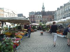 When we first moved to Belgium, we stayed at a hotel close to the flower market. I loved going and looking at the flowers, it was a highlight of the week.  The Flower Market at Le Gran Place Mons, Belgium