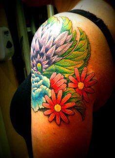 Upper Arm Flower Tattoo. Lovin the brightness