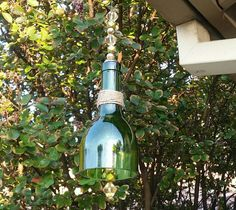 Check out this item in my Etsy shop https://www.etsy.com/listing/252219971/recycled-wine-bottle-hurricane-topper