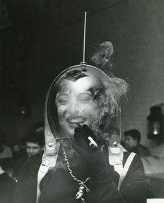 Woman in a Space Helmet Smoking a Cigarette, ca.1950, ph. Weegee