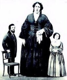 Sylvia Hardy (1824-1888) was known as  The Maine Giantess.  She started growing tall as a teenager and reached her full height of about 7'0'' at age 40.  She worked for P.T. Barnum and was a friend of Charles Stratton (Tom Thumb) and his wife.  After retiring from the circus, she returned to Maine and became a spiritualist and medium.