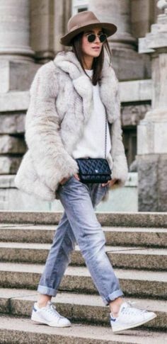 A big faux fur coat will add instant glamour to any look. Lena Lademann wears this classic white fur over a knit sweater and boyfriend jeans, an edgy every day look which is ideal for the winter season. Winter Fur Coats, Best Winter Coats, Winter Overcoat, Winter Trends, Winter Ideas, Boyfriend Jeans, Look Fashion, Fashion Outfits, Fashion Check
