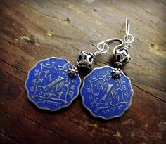 Currency. Earrings made with vintage coins from India, coloured with metal inks or enamels.