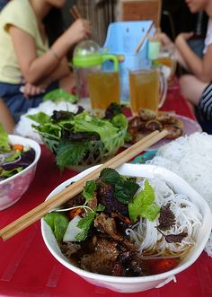 in Hanoi, Andrea finds great street eats via the female food vendors and where THEY eat lunch. Looks mouth watering, doesn't it?
