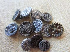 Vintage Buttons - Collector molded metal, pressed and molded, Victorian lot of 12 assorted designs, very old (feb 163b) by pillowtalkswf on Etsy