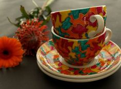 Coffee or Tea Cup & Saucer from the Elmer collection. A colourful design to bring that touch of luxury and creativity to your morning ritual. Hand Painted Ceramics by artist Caro Spinette. Photo by Kate Sims