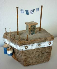 A beast! Made of found hardwood (poss oak?)  Weighs a ton!   Chunky driftwood boat by Kirsty Elson Designs