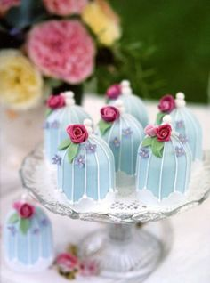 tiny cakes made as bird cages...