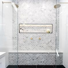Fish scale tile, also known as mermaid tile. Beautiful modern bathrooms and kitchens Fish scale tile, also known as mermaid tile. Beautiful modern bathrooms and kitchens Bad Inspiration, Bathroom Inspiration, Double Shower Heads, Fish Scale Tile, Shower Niche, Shower Seat, Shower With Bench, Master Shower Tile, Shower Benches