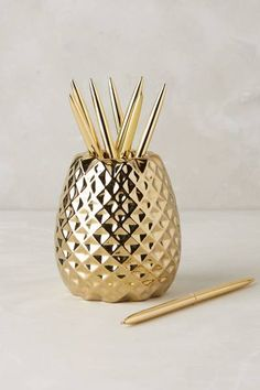 Anthropologie Pineapple Pencil Holder: http://www.stylemepretty.com/living/2015/11/10/the-best-office-supplies-to-dress-up-your-desk/