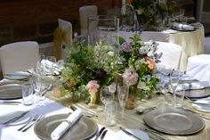Table centrepiece with Yorkshire flowers at Goldsborough Hall. Flowers by Twisted Willow. Styling and chair covers by Simply Bows and Chairs