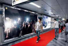 Unsuspecting pedestrians walk the red carpet with an interactive paparazzi wall from Nikon. Genius! Brought to you by Shoplet Promos - everything for your business.