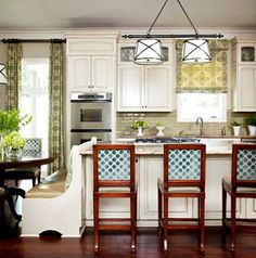 Great curtains.  Love the wide, dark hardwoods.  I love benches at tables.