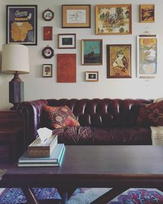 gallery wall, chesterfield sofa