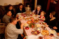 A Russian family enjoying a celebratory meal together in a Moscow apartment. Russia.: Russia, Moscow: Arctic & Antarctic photographs, pictures & images from Bryan & Cherry Alexander Photography.