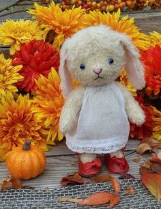Matilda bunny loves the colours of autumn...dress warmer wee Matilda! Soft cream-coloured mohair bunny wearing simple white dress and red antique doll shoes. Pattern available from sotreasuredshop on Etsy. See sotreasured.com for more details. Hugs xo