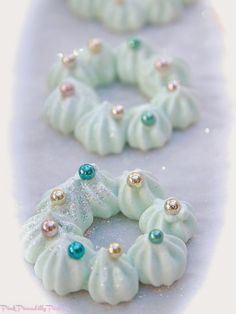 Sparkly Pastel Meringue Wreath Ornaments- @joannegallaway, you could totally make these and make them a lot more cute :) something for Christmas sales?