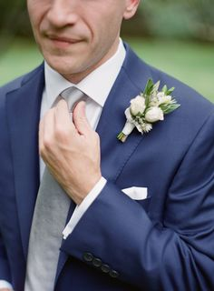 Ryan's navy suit with flowers by @floressence. Photo: @almondleaf http://ashevilleeventco.com/blog/jenny-ryans-highlands-wedding/