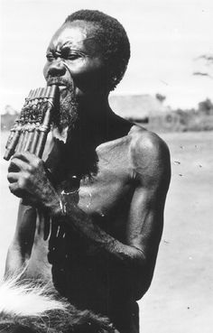 ILAM archival images. Luba man playing mishiba panpipes, Katanga Province, Democratic Republic of Congo, 1952. Photo by H. Goldstein. Courtesy of the International Library of African Music (ILAM).