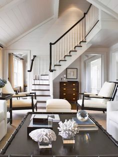 Nantucket by Matthew Sapera Fine Homes. Absolutely beautiful design that focus on the wood and the multitude of finishes and textures as opposed to any sort of color. Love the combination of the pair of dark wood spool chairs and the similarly dark coffee table with faux bamboo trim. Could have same effect with dark leather sectional