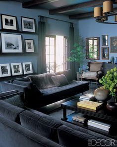 *******ok, this is kinda the feel for your living room.  the velvet couches would be nice.  classy, masculine, and that modern/retro feel.  the walls are just a bit too blue.  but envision with a greyer wall.  the pictures are nice.  couch is nice.  get it?