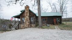 Tranquil, private, w/spectacular view of the Ozarks! An immaculate custom log home on 20 AC. 4 BR, 3-1/2 Ba, walk-in closet, Master en-suite, sitting areas, custom kitchen, butler pantry, 2 covered decks, walk out basement, w/spring fed creek, bluffs, and woods! Interior storage. 3 car garage for cars & toys. Well-loved property has custom blinds and drapes, flowers, pond, and fenced garden plot. Minutes from Buck Creek Marina, Bull Shoals Lake and Ferry in Protem MO