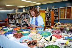 Anharad Edson oversees the painting of some of the bowls waiting to be filled during Long Trail School's 'Empty Bowls' dinner on