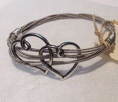 Love this recycled guitar string heart bracelet.