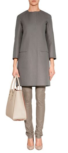 With a characteristic minimalist look and chic retro-style silhouette, Jil Sander's collarless cotton coat lends an immaculate polish to modern wardrobes #Stylebop