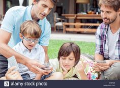 Same-sex couple playing card game with sons Stock Photo, Royalty Free Image: 79505894 - Alamy