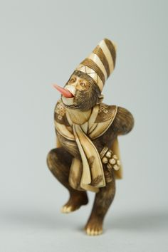 Netsuke of Monkey Wearing a Tall Cap and Carrying a Fan | Japan | The Met