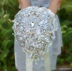 Crystal teardrop cascading brooch bouquet  deposit on a by Noaki, $250.00