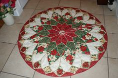 Papillon Pals: Christmas Tree Skirt (no pattern, but does have a book reference)