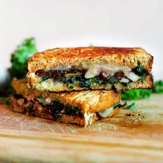 A classic grilled cheese sandwich made a bit healthier with sautéed greens and mushrooms.