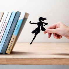 These fun metal bookshelves give the impression that a stealthy superhero is saving your books from certain doom. Lean your books against the specially angled shelf and watch your caped crusader, with the aid of a well-hidden and super-strong magnet, save them from a tragic fate. #girlpower