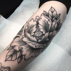 Freehand peony Ash's tattoo