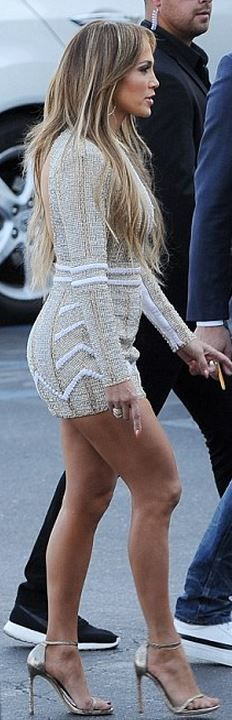Who made Jennifer Lopez's gold sandals, jewelry, and nude beaded dress?…