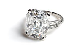 Cartier classics - Cartier made the engagement ring worn by HSH Princess Grace of Monaco, American actress Grace Kelly, in 1956. The platinum ring is set with a 10.48-carat emerald-cut diamond flanked by two baguettes.