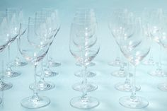 Rows of white wine glasses by CatMacBride | Stocksy United